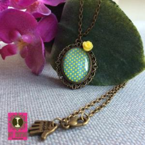 BFF Vintage ketting brons ovalen hanger met vintage geel motief en bijpassend roosje