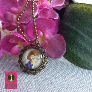 BFF Vintage ketting brons ronde hanger met vintage dame met bloem in het haar